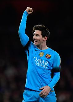 Barcelona's Argentinian forward Lionel Messi celebrates scoring his team's second goal from the penalty spot during the UEFA Champions League round of 16 1st leg football match between Arsenal and Barcelona at the Emirates Stadium in London on February 23, 2016. Barcelona won the match 2-0.