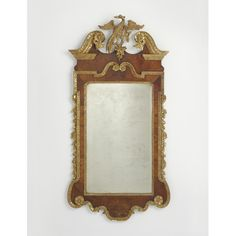 A GEORGE II CARVED AND VENEERED WALNUT AND PARCEL-GILT PIER MIRROR, CIRCA 1740