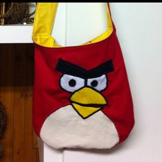 I made this Angry Birds purse for my daughter. I used the Lola owl purse pattern for the body. The face is felt...traced from a picture I printed....and is zig-zagged with black thread.