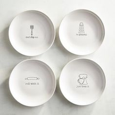 Crafted of glazed white ceramic, each appetizer plate in our charming set features a different fun phrase. Whether you fill them with macaroons, deviled eggs or bruschetta, you'll be enjoying a side of style as well.