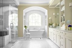 Another view of the lovely bathroom with the great drawer handles and gorgeous shower. Love the bath down by the window!