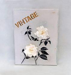 Tableau peint à la main sur toile pour un style déco simple, authentique et chic.   Deux gardénias blancs naturels sublimés, symbole de sincérité en langage des fleurs, apportent une touche délicate et raffinée à cette création artisanale unique.  Dimensions : 27 cm x 35 cm