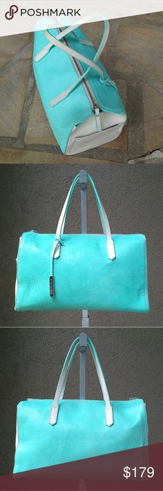 "INNUE Unbelievable Italian Leather Handbag Wow. Gorgeous light aqua blue green, with light tan / stone soft supple leather. Suede polka dotted side pockets with lace. 5 feet on the base. Brand new condition with no faults to note, although there is some manufacturing glue at the top zipper as shown. Innue logo key fob. Interior has 1 zip pocket, 2 open pockets. Approx meas: 14"" wide, 8.5-9"" tall, 7"" deep at the bottom, strap drop 6"".  Genuine leather. Made in Italy. Innue Bags Satchels"