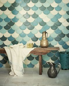Keep up with tile trends. Fish scale tiles are a great way to update your kitchen or bathroom. Replace your subway tile with fish scale tile to stay on trend. For more design ideas and inspiration, go to Domino. Moroccan Bathroom, Grey Bathroom Tiles, Bohemian Bathroom, Moroccan Tiles, Moroccan Pattern, Blue Green Bathrooms, Small Bathrooms, Bathroom Green, Mermaid Tile