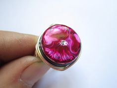 'Striking Pink Enamel Ring' is going up for auction at  9am Mon, Jun 18 with a starting bid of $12.