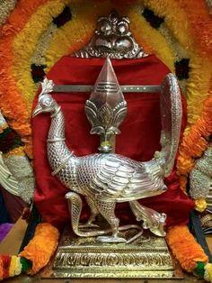 The peacock and Vel (spear) symbols of Murugan, son of Shiva.