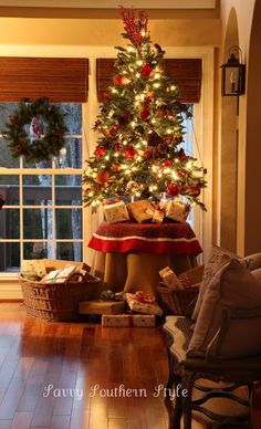 Savvy Southern Style: The Tree  4.5 foot tree on round table with burlap cover than plaid.  Presents on table and in baskets on floor