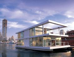 Dubai houseboat. The 220-square meter home was cleverly designed by Dubai-based architectural firm X-Architects. Set on two catamaran beams, this two-story structure is encased in glass windows, allowing sunlight to flood the interior.