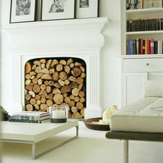 Logs and monochrome pictures highlight the fireplace