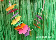 Make a lei on the first day, adding words that describe each student!