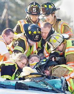 I can't remember how many times I've seen my husband do this- Volunteer Firefighters are unsung heroes!  (by Al Malpa, The Chronicle)