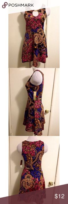 Nicki Minaj Sexy Snake Design Dress Small New With Tags! Size: Small Brand: Nicki Minaj Material: 95% Polyester 5% Spandex Nicki Minaj Dresses Mini