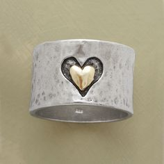 """HEART AND SOUL RING--A heart and soul band ring, marrying precious metals and textures, with a heart hand cast into our 1/2""""-wide hammered sterling band framing another of smoothly finished 14kt gold. A Sundance exclusive in whole and half sizes 5 to 9-1/2."""