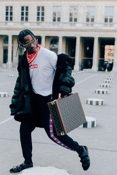 Travis Scott attended the Louis Vuitton Fall/Winter 2017 show during Paris Fashion Week. The Houston rapper was wearing Louis Vuitton sandals, and the new Louis Vuitton x Supreme collaboration t-shirt and sunglasses. Travis Scott also wore a pair of Champion x Vetements sweatpants, Paris, 2017