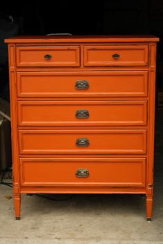 Orange painted dresser. You can get this look without primer or sanding by using Chalk Paint.
