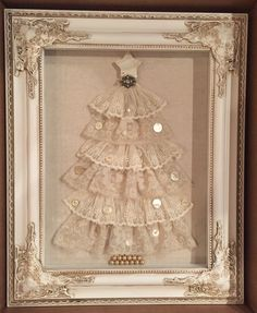 Antique lace and buttons Christmas tree in shadow box.