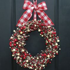 Faux berry Christmas wreath.  #Christmas #Decorations #Outdoor Sherman Financial Group