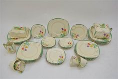 Lot 978 An attractive and extensive Art Deco Burleigh ware tea and dinner service, 'Tulip Time' pattern pattern painted with bright florals and black dash border. Staceys Auction May estimate Sold, no price released