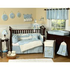 This fish themed nine piece baby bedding set was created by Sweet Jojo Designs. This set includes a blanket, crib bumper, crib skirt, fitted sheet, toy bag, decorative throw pillow, diaper stacker, and two window valances.