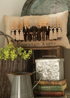 "Show your Downton Abbey spirit with our charming Downton Cast pillow. It features the iconic Highclere Castle and downstairs cast printed on a rich, warm ground. Details - Pillow cover measures 12"" x"