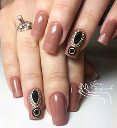 If you look closely, you'll notice a discreet french manicure but in the same color. With that, part of the nail closest to the root of nail is shiney, and the upper part is mat. The color of meat is very nice paired with black rhinestones that gives the soul the whole manicure.