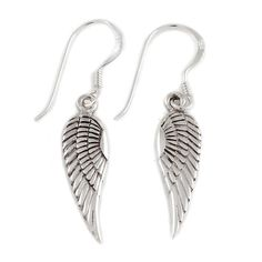 small silver angel wing earrings by charlotte's web | notonthehighstreet.com