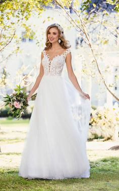 Laidback, casual and oh-so-chic, this beach wedding dress from Stella York was made for your oceanside celebration! The breathtaking, lace bodice of this gown features a light, organza underlay, adding to the illusion of a sheer bodice, while providing a bit of coverage. The illusion-lace neckline features organic lace detailing and an off-the-shoulder look, which only enhances the beachy feel. The back of this gown is highlighted with open, illusion tulle and lace detailing, giving it an…
