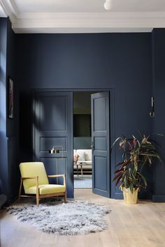 love the midnight blue.  pop of colour with the yellow chair.