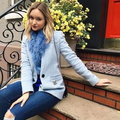 A baby blue blazer and matching faux fur