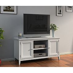 @Overstock - Bring an urban, chic decor to your living room with this white media console. This stylish console is includes a 50-inch plasma TV LCD stand. This stand has a modern feel and offers two shelves, two doors, and is made of wood veneer and hardwood. http://www.overstock.com/Home-Garden/White-50-inch-Plasma-TV-LCD-Stand-Media-Console/6644406/product.html?CID=214117 $214.99