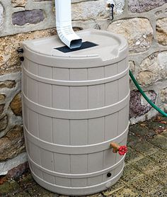 Really great idea for saving water! Rain water is better to water flower beds with, so this is an awesome idea but I would seal the barrel around the down spout. You can hook up your hose and water your garden too.