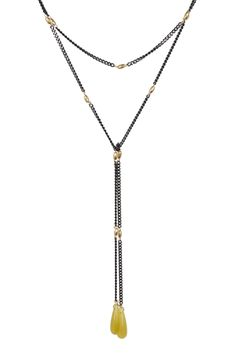 This lariat is lighter than air and so versatile youll want to wear it several different ways. Gold beads are interspersed along a 44 gunmetal chain with resin beads at either end. - Gunmetal, gold beads, polished jade