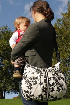 """Stephanie from Hamilton NJ says """"It's so perfect because it really does hold quite a bit, and it doesn't jump out and scream diaper bag. Easy access pockets are huge in the front and back and the 2 side insulated pockets are a bonus!"""""""