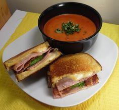 Tomato basil soup and grilled cheese and ham sandwich with bacon and avocado