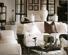 Beautiful espresso shutters are a striking balance to a crisp white decor.