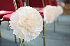 Giant paper pompoms from @pompomfactory, used as wedding decorations.