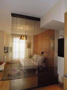 This divider looks like it might just be blinds, but it has a clean, modern look.