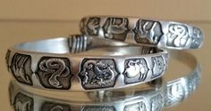 Hey, I found this really awesome Etsy listing at https://www.etsy.com/listing/264081874/two-silver-bracelets-chinese-animal