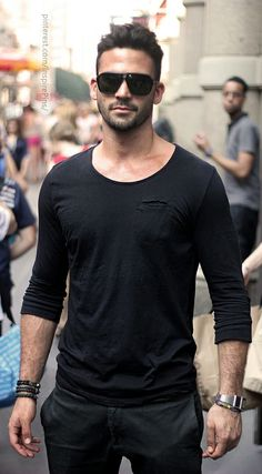 Shop this look for $62: http://lookastic.com/men/looks/black-crew-neck-t-shirt-and-black-chinos-and-black-sunglasses-and-silver-watch/2653 — Black Crew-neck T-shirt — Black Chinos — Black Sunglasses — Silver Watch