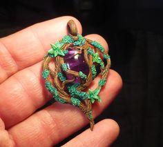 http://ganjamira.deviantart.com/art/Nightelf-Amulet-handsculpted-Pendant-450427631