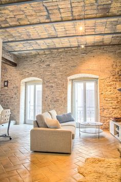 vaulted ceiling stone walls terracotta floors by Turn Key Italia