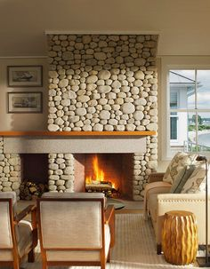 transitional living room by Estes/Twombly Architects, Inc.  I like that the mantel goes beyond the fireplace.