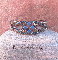 The Diamond Duchess in Blue Suede  The delicate alternating weave of this…