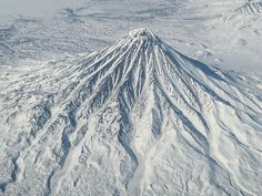 Crossing from Alaska to Siberia above Krosnotsky volcano, reportedly one of the most beautiful in the world.