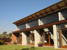 House Taylor, designed for well known sculptor in Pretoria, South Africa. Through the novel use of windows and skylights as design features, the home also functions as a gallery for the client's own work and art collection. The client was directly involved with the construction. As a result, the finishes and materials used are bold, raw and innovative, creating a home ideally suited to the client's own sculptural creations. Completed in 2008. Photos by Rina Stutzer, Jonathan O'Connell, MAAA. Pretoria, Skylights, Residential Architecture, South Africa, Construction, Windows, Contemporary, Gallery, Outdoor Decor