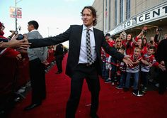 CHICAGO IL - OCTOBER 01: Duncan Keith #2 Chicago Blackhawks greets fans during 'red carpet' event before Blackhawks take WashingtCapitals