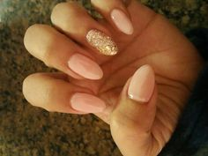 Almond shape acrylic and gel on top. Nude gold glitter on my ring finger. I love…