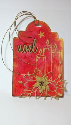 http://www.stampingwithloll.com/2016/11/day-one-twelve-tags-of-christmas.html Another alcohol ink background...not as dark as previous one.  After blending inks and adding Inka Gold on edges and swipes on tag, I sponged black on edge to contain the image.  Added layered poinsettia to center of candle poinsettia. Stamped star and cut 2 Noel die cuts and layered them for emphasis.  I will be using my tags as Christmas cards, adhering them to a base card.
