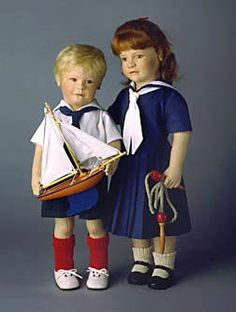 "Arthur with Sailboat (left in photo) 18"" molded felt, fully jointed. Holds wooden sailboat. Date of Release: 1987-89. Ltd. Ed. 500.  Lillian with Jump rope. (right in photo) 20"" molded felt, fully jointed. Holds wooden jump rope. Date of Release: 1987-89. Ltd. Ed. 500."