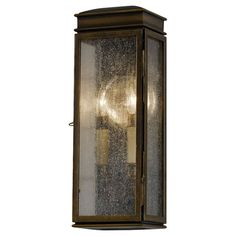 The Astral Bronze outdoor wall light from the Whitaker collection is a fresh interpretation of the classic English pocket lantern. A traditional latched door allows for easy re-lamping. The polished nickel reflector is both historically accurate and increases light output. Designed with a five inch square black plate to allow easy installation on a home with lap siding. Features stainless steel frame, solid brass hinge and latch and powder coated steel roof base.  Bellacor.com